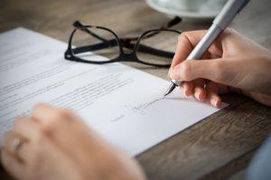 >thisisjustarandomplaceholder<Signing a form | Iberian Press®