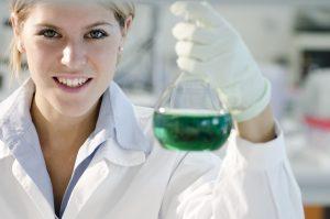 >thisisjustarandomplaceholder<Young female researcher working with beaker | Iberian Press®