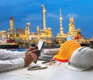 >thisisjustarandomplaceholder<engineering working on computer tablet  against beautiful oil refinery background   Iberian Press®